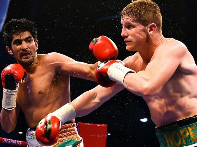 Star Indian boxer Vijender Singh hits his opponent Australia's Kerry Hope during the WBO Asia Pacific Super Middleweight Championship 'Title Fight' at Thyagaraj Sports Complex in New Delhi on Saturday.