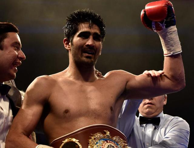 Vijender Singh's wife, Archana, is superstitious that  her husband could lose if she watched his bouts. She didn't have to worry on Saturday as he earned a unanimous decision against Australia's Kerry Hope to claim the WB Asia Pacific Super Middleweight belt.