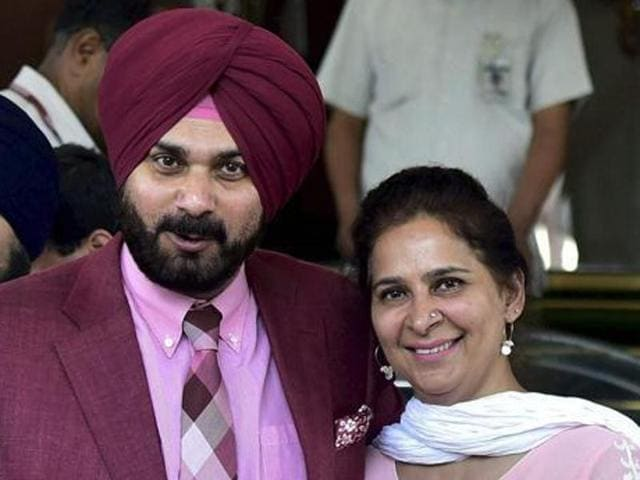 Cricketer-turned-politician Navjot Singh Sidhu with his wife Navjot Kaur Sidhu outside Parliament in New Delhi.