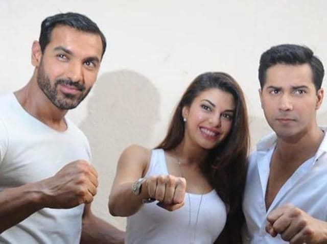Jacqueline Fernandez poses with John Abraham and Varun Dhawan during the announcement for the Hindi film Dishoom on April 18, 2016. (AFP)