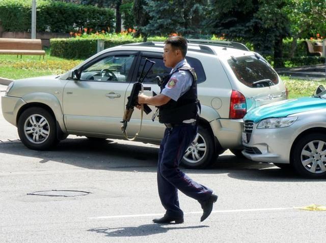 A policeman runs across the street in Almaty, Kazakhstan.