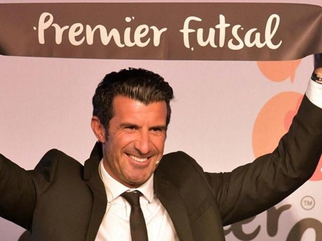 Luis Figo pose for media during the announcement of Premier Futsal league in Mumbai.