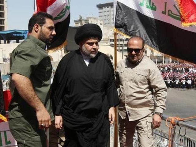 Iraqi Shia cleric Moqtada al Sadr speaks during a protest against corruption at Tahrir Square in Baghdad.