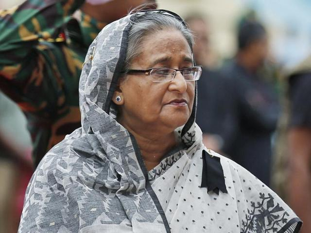 Bangladesh's Prime Minister Sheikh Hasina offers her tribute to the victims of the attack on Holey Artisan Bakery, at a stadium in Dhaka.