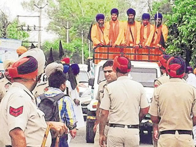 Police stopping protesters against the recent desecration of Guru Granth Sahib in Talwandi Sabo, in Bathinda on Sunday.