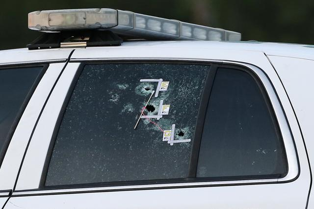 An East Baton Rouge Sheriff vehicle is seen with bullet holes in its windows in Baton Rouge, Louisiana, US.