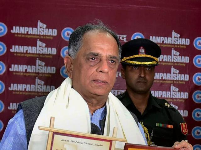 West Bengal Governor Kesharinath Tripathi presents 'Kulbhushan Dallori' award to Central Board of Film Certification Chairperson Pahlaj Nihalani during an annual function of Janparishad in Bhopal .