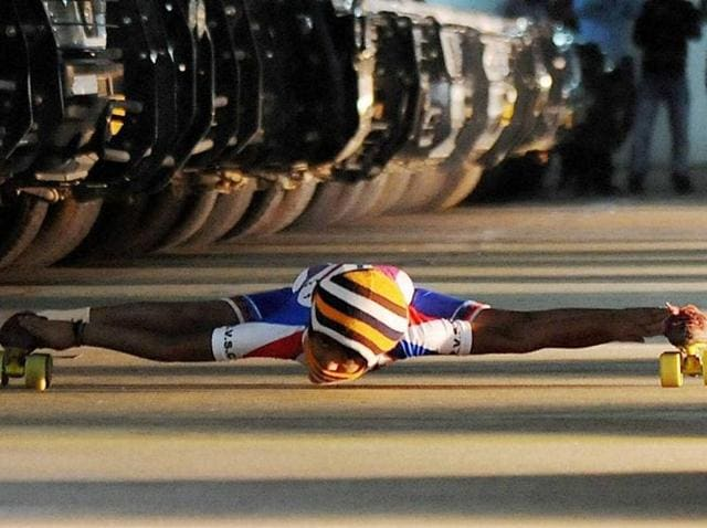 The kid, Om Prakash Gowda, held his body parallel to the ground and skated under 35 cars in a row, covering a distance of 65 meters.