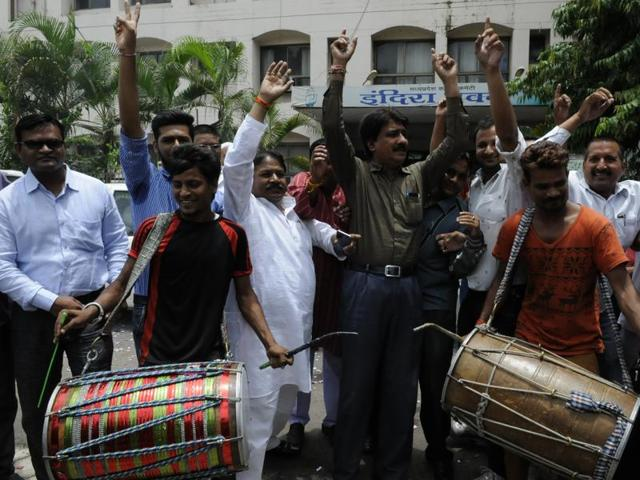 Congress workers celebrating party's win in local body elections, at the PCC office in Bhopal on Monday.