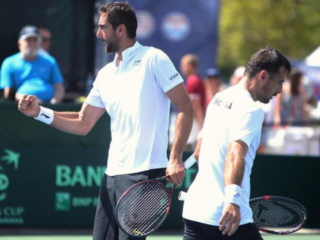 Croatia's Ivan Dodig, right, and Marin Cilic react during a win over the United States in Davis Cup 2016.