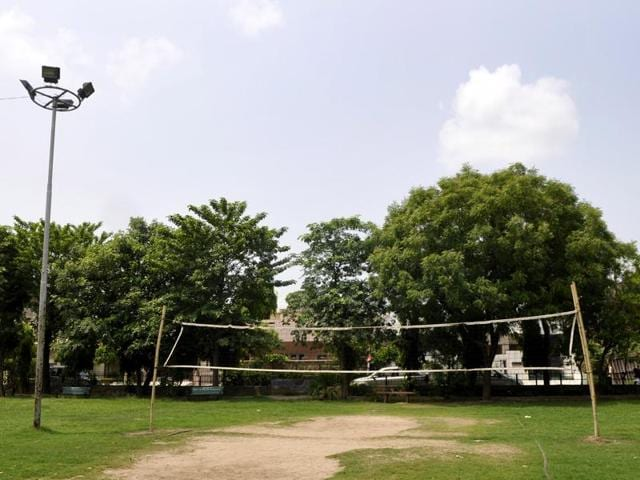 Residents set up a volleyball net and swing sets for children at local park to encourage outdoor activities among kids.