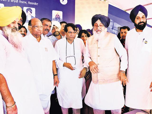 Where is Punjab BJP president Vijay Sampla? Almost obscure behind Nationalist Congress Party president Sharad Pawar (second from left) as Punjab chief minister Parkash Singh Badal and state revenue minister Bikram Singh Majithia rub shoulders with Union railway minister Suresh Prabhu (centre) during the stone-laying ceremony of a college at Ghuman village in Gurdaspur district on Sunday.