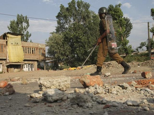 A soldier walks towards their base camp on the ninth straight day of curfew in Srinagar.