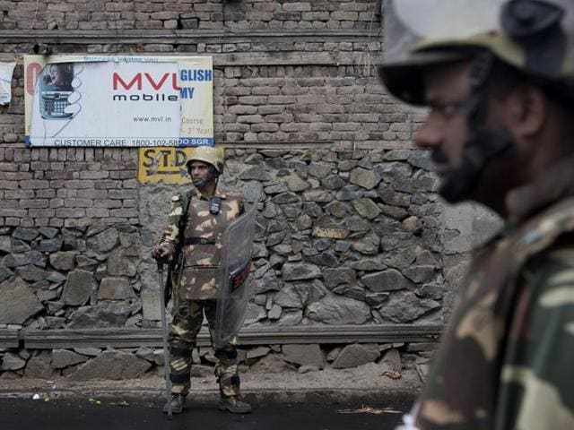 Paramilitary soldiers stand guard during the tenth straight day of curfew in Srinagar.