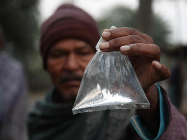 At least 32 people have died in Uttar Pradesh's Etah district after consuming hooch sold in Rs 10 polythene pouches.