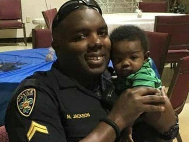 This undated photo provided by Trenisha Jackson shows her husband and Baton Rouge police officer Montrell Jackson, one of the three Baton Rouge law enforcement officers who were killed on Sunday.