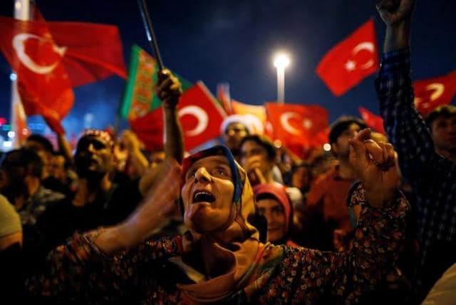 Supporters of Turkish President Tayyip Erdogan attend a pro-government demonstration on Taksim square in Istanbul.