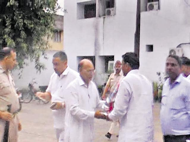The video shows jail officials (above) accepting money from a supporter of former MP Narendra Kashyap following his release.