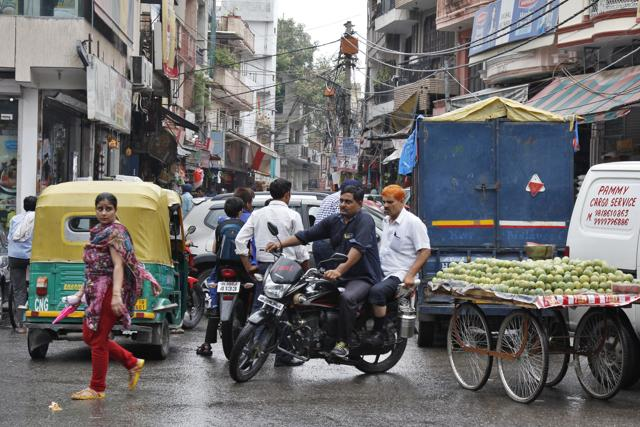 The footpath has been taken over by food outlets, pan shops and other small kiosks extending till the main road, leaving no space for pedestrians.