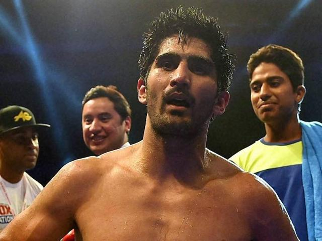Boxer Vijender Singh celebrates after beating Australia's Kerry Hope and clinching the WBO Asia Pacific Super Middleweight Championship.