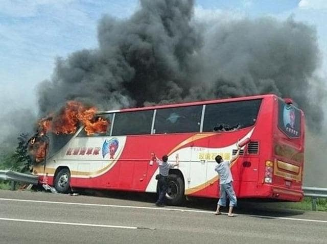 Taiwanese media reports said 26 people were killed after a tour bus burst into flames on a busy highway.