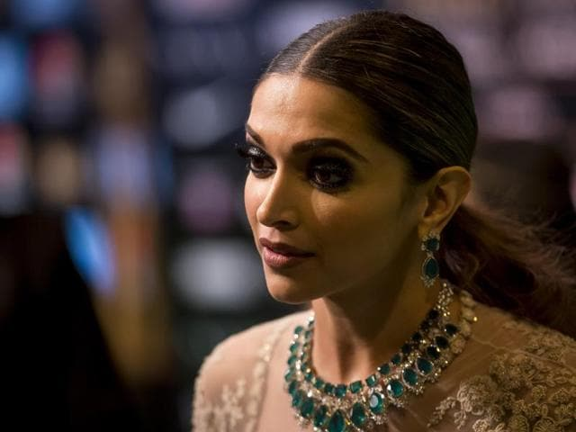 Bollywood actress Deepika Padukone poses for photographers at the International Indian Film Academy (IIFA) Rocks Green Carpet for the 17th Edition of IIFA Weekend & Awards in Madrid, Spain, Saturday, June 25, 2016. (AP Photo/Samuel de Roman)