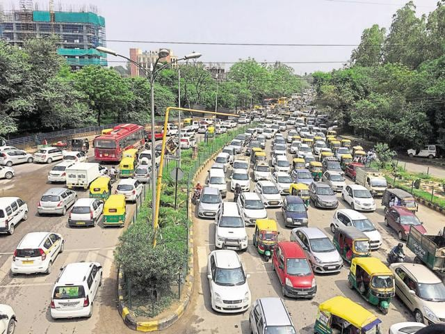 Bumber-to-bumper traffic at Signature Tower Chowk in Gurgaon on Monday.