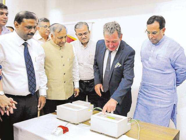 Haryana minister for finance Capt Abhimanyu Singh (right) and MD of Secty Electronics, Germany, Juergen Przybylak (second from right) inaugurate the earthquake warning system in HIPA on Monday.