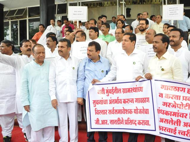 Opposition leaders protest outside the Assembly against the government during the monsoon session of the Maharashtra Legislature on Monday.