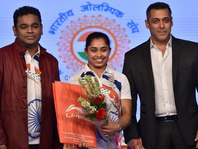 Indian gymnast Dipa Karmakar is flanked by Indian Bollywood actor Salman Khan and music composer AR Rahman.
