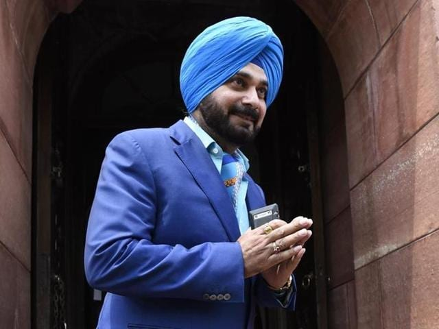 Former Indian cricketer Navjot Singh Sidhu arrives for the parliament session in New Delhi.