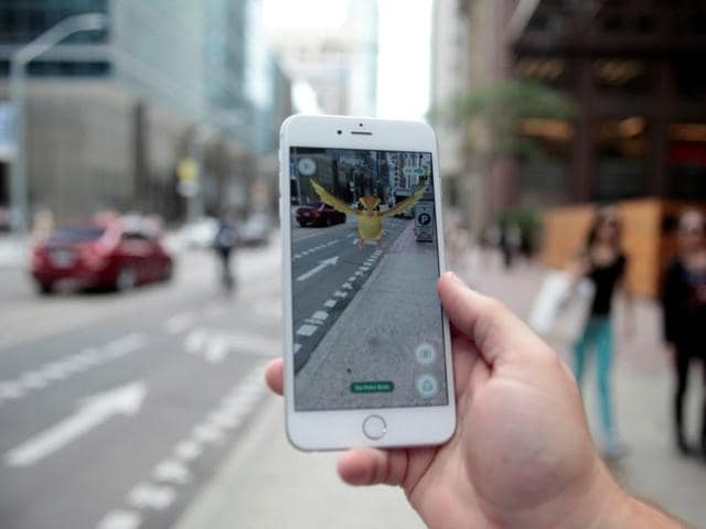 A 'Pidgey' Pokemon is seen on the screen of the Pokemon Go mobile app, Nintendo's new scavenger hunt game which utilizes geo-positioning.