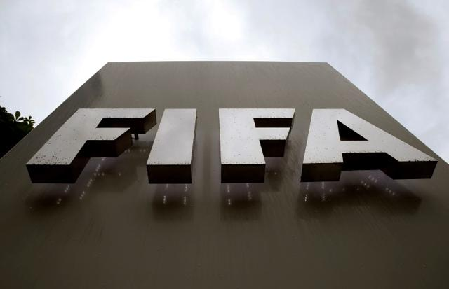 Raindrops flow down on a logo in front of FIFA's headquarters in Zurich, Switzerland.