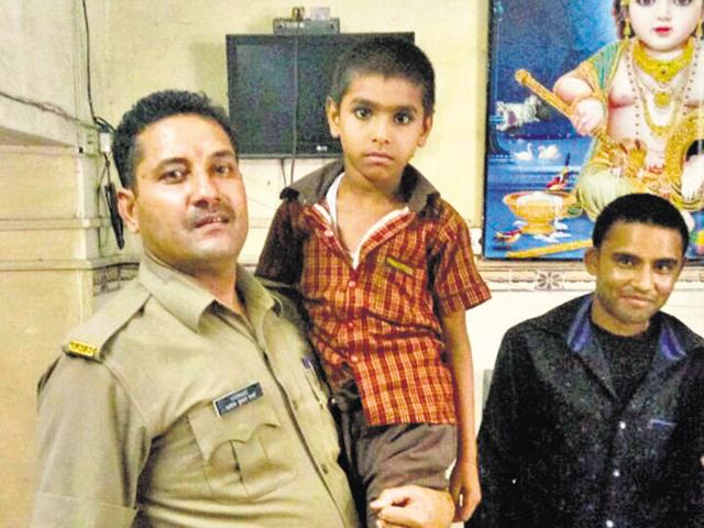 Ankush with Ghaziabad police constable Adesh Kumar Sharma whose efforts helped trace his family in Delhi.