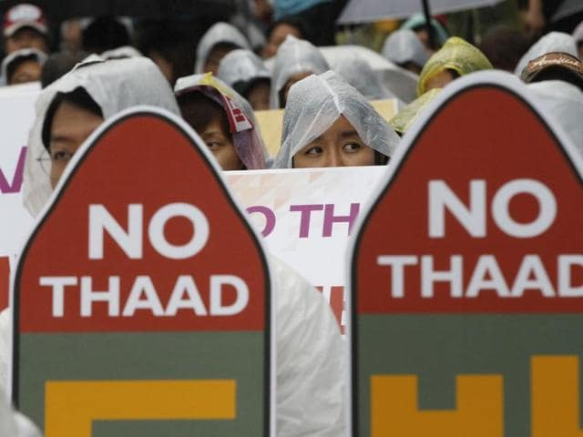 South Korean protesters attend a rally to oppose a deployment of the Terminal High-Altitude Area Defence in Seoul, South Korea.