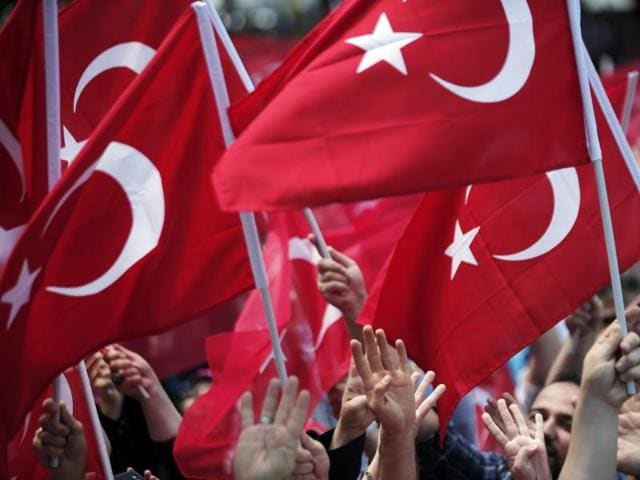 Pro-government supporters wave Turkish flags as they protest against the attempted coup, in Istanbul, Tuesday, July 19, 2016. The Turkish government accelerated its crackdown on alleged plotters of the failed coup against President Recep Tayyip Erdogan.