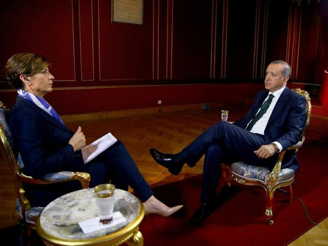 Turkish President Recep Tayyip Erdogan talks during an exclusive interview with CNN's Becky Anderson at his office in Istanbul.