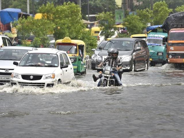Waterlogging outside Okhla Mandi on Monday.South Delhi was the worst hit with traffic snarls at IIT-Delhi, Munirka, Moti Bagh, Chirag Delhi, Saket, Modi Mill, Moolchand, South Extension, Yusuf Sarai, AIIMS and Andrews Ganj.