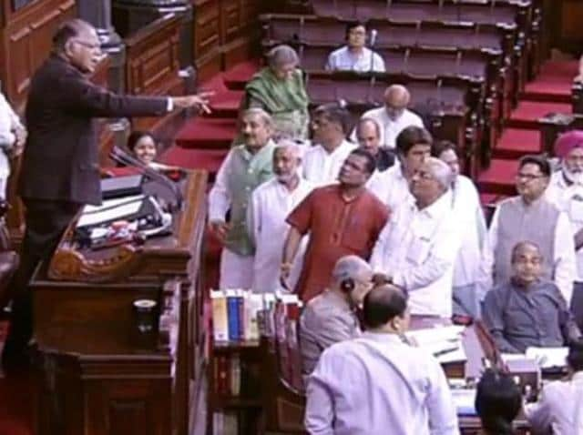 Deputy chairman of the Rajya Sabha, PJKurien, attempts restore order in the house as opposition leaders raised slogans against the BJP-led NDA over the violence against Dalits in Gujarat.