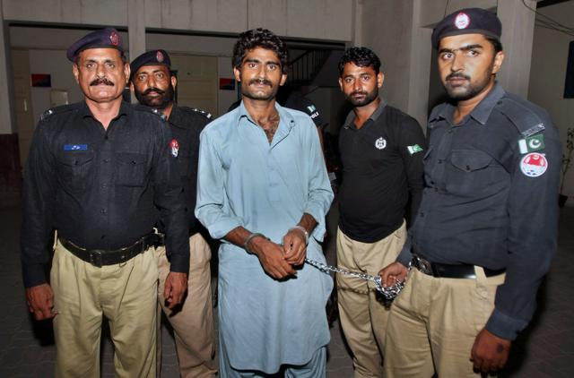 Pakistani police officers present Muhammad Waseem Azeem -- the brother of slain model Qandeel Baloch -- before the media following his arrest at a police station in Multan, Pakistan on July 17.