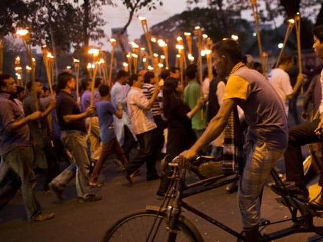 Demonstrators take part in a candlelight march in Dhaka to demand justice for liberal bloggers attacked of their writings.