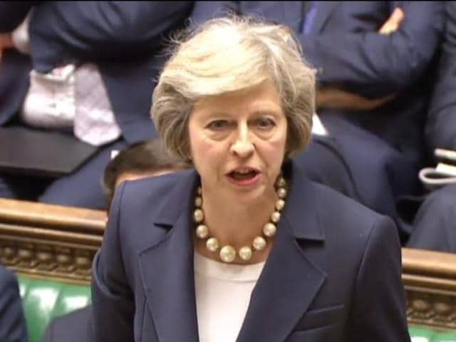 British Prime Minister Theresa May leaves 10 Downing street in London on Wednesday on her way to the House of Commons to face her first session of Prime Ministers Questions.