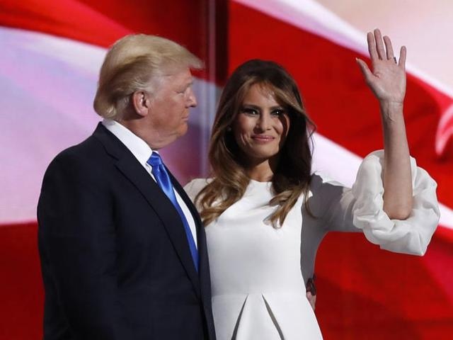 Melania Trump stands with her husband Republican presidential candidate Donald Trump at the Republican National Convention in Cleveland, Ohio, July 18, 2016.