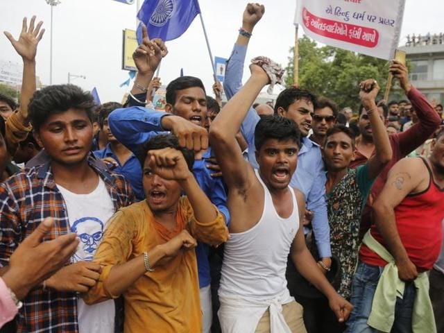 Dalits protest against the alleged attack on community members for skinning a cow in Una, in Ahmedabad.