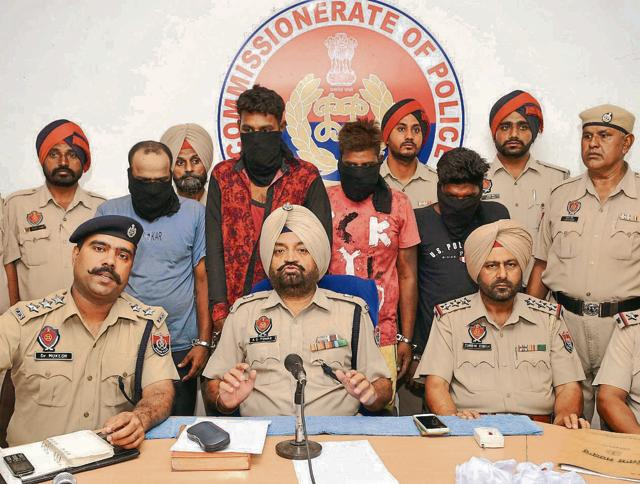 Police officials addressing mediapersons in Jalandhar on Tuesday.
