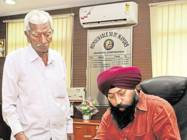 Senior deputy mayor Kamaljit Singh Bhatia working at the MC office in Jalandhar on Tuesday.
