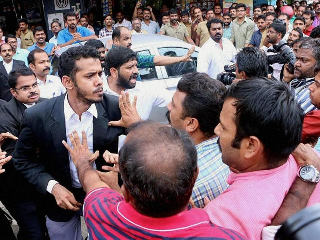 Lawyers attacking media persons during their protest march in front of Kerala high court in Kochi on Wednesday.