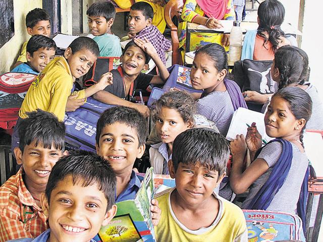 Students attending classes in corridors at Government Primary School, Giaspura, in Ludhiana on Tuesday.