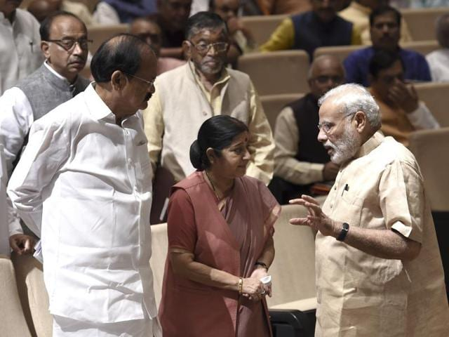 Prime Minster Narendra Modi with external affairs minister Sushma Swaraj and information and broadcasting minister Venkaiah Naidu at the BJP parliamentary party meeting in New Delhi.