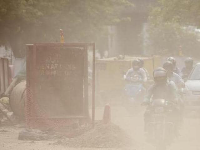 Dust from construction waste is one of the contributors to pollution in the city. A construction site on Bhairon Marg in New Delhi.